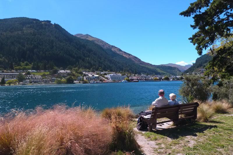 Elderly couple - New Zealand lake and mountains